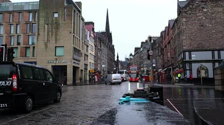 fife : August 2017: People crossing the street. The day is cold and rainy. August 2017 in Edimburgh