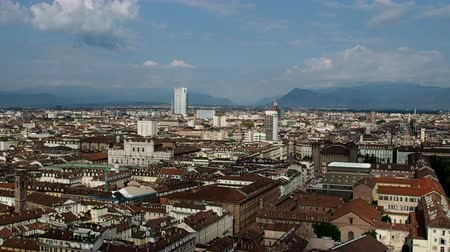 visto : August 2018: aerial view of the city. You can see the Littoria tower, the Palazzo di Intesa San Paolo and the Risorgimento museum. In the distance you can see the Alps. August 2018 in Turin