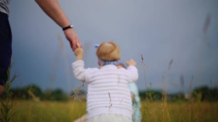 littlegirl : father helping his daughter to take first step of life Stock Footage