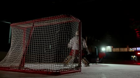 hockey rink : Professional hockey players play the shootout. The player who takes the penalty a hockey goalkeeper. Steadicam.