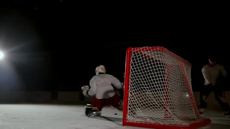 trest : Professional hockey players play the shootout. The player who takes the penalty a hockey goalkeeper. Steadicam.