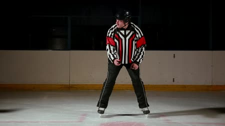 faceoff : hockey referee produces a faceoff and the two players begin to fight for the puck