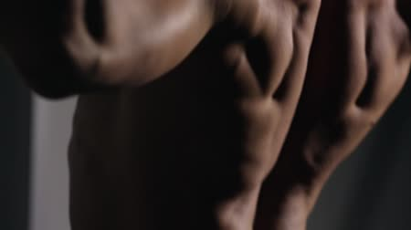 back side : rolled man performs pull-UPS closeup in the gym. You can see all the muscles. Stock Footage