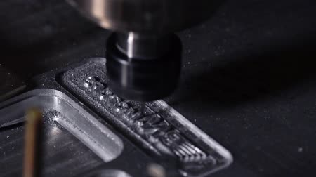 fixing : Modern production for the creation of aluminum plates. Beautiful drilling process