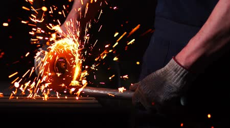 angle grinder : industrial engineer working on cutting a metal and steel with compound mitre saw with sharp, circular blade