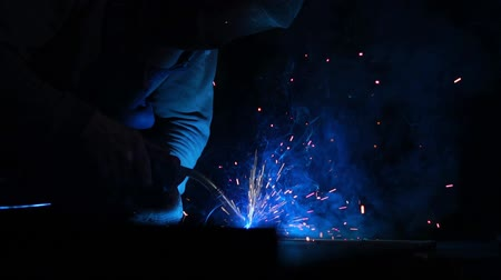 equipamento : Closeup industrial Worker at the factory welding, Worker welding at industrial factory.