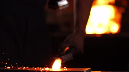 charcoal stove : Closeup of a blacksmiths hammer on the background of burning flames of the furnace. Stock Footage