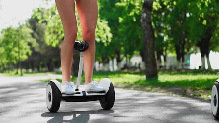 self balancing : Close-up of female foot nor white GyroScooter in slow motion close-up Stock Footage