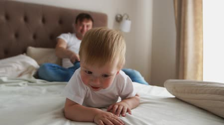 acrobats : Dad plays with his son lying in krvoi, laughter and smiles Stock Footage
