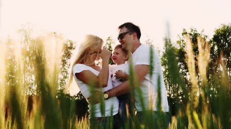 kiddy : The mother and father hugging their son Stock Footage