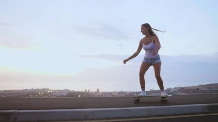 sky only : The girl is engaged in sports skateboarding with mountain Stock Footage