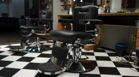 fryzjerstwo : Authentic haircut for men. Barbershop in retro style. Steadicam shot Wideo