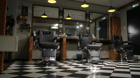 fryzjerstwo : the camera on the Steadicam shows the interior of a Barber shop with a beautiful design. Wideo