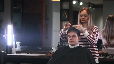 makas : Mens hair salon, the girl makes a haircut scissors in a brutal interior.