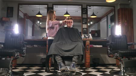barber hair cut : Rear view of man client visiting haidresser and hairstylist in barber shop.