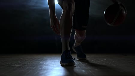 top sürme : Dribbling basketball player close-up in dark room in smoke close-up in slow motion Stok Video