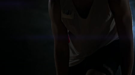 терпение : Dribbling basketball player close-up in dark room in smoke close-up in slow motion Стоковые видеозаписи