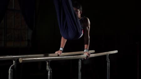 desigual : portrait of young man gymnasts competing in the stadium