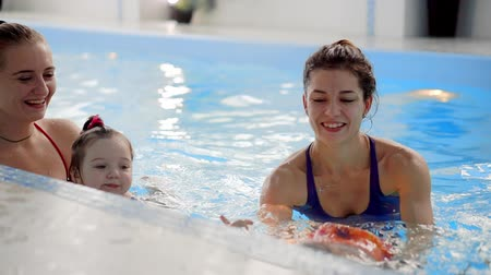 pelenka : Group of mums with their baby children at infant swimming class