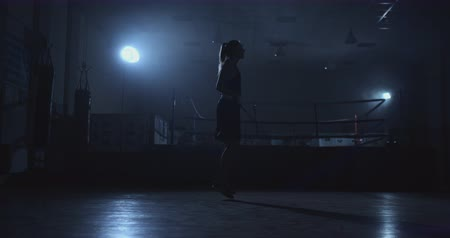 ficando : Beautiful woman boxer jumping in the Boxing gym near the ring on the jumpers Stock Footage
