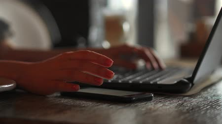 portable information device : Closeup of business woman hand typing on laptop keyboard. Closeup of a female hands busy typing on a laptop. Womans hands pressing keys on a laptop keyboard trying to access data.