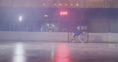 western script : Hockey player carries out an attack on the opponents goal and scores a goal in extra time. The player brings victory to his team in shootouts Stock Footage