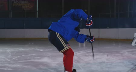 western script : Hockey player conducts an attack on the opponents goal. Lying in a helmet catches the puck and saves the match. Hockey player man of the match Stock Footage