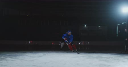 western script : Two professional hockey men fighting for the puck on the ice arena using force techniques Stock Footage