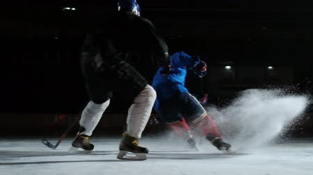 western script : Two man playing hockey on ice rink. hockey Two hockey players fighting for puck. STEADICAM SHOT