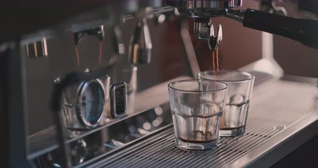 cheerfulness : Coffee flows from cofee machine in slow motion