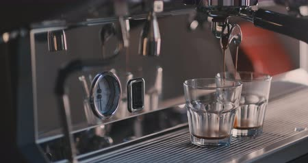 kahve molası : Female tender hand putting glass with chocolate and condensed milk in a milk frother of a coffee machine. Close-up concept