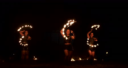 pirotecnia : Slow motion: Professional fire performance three women with torches and a man with flamethrowers