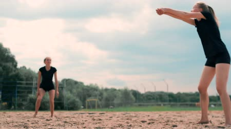 knock : summer vacation, sport and people concept - young woman with ball playing volleyball on beach.