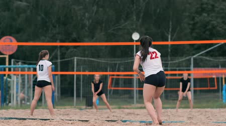 volleyball : Professional volleyball serve woman on the beach tournament. Volleyball net the player blocks the view when applying Stock Footage