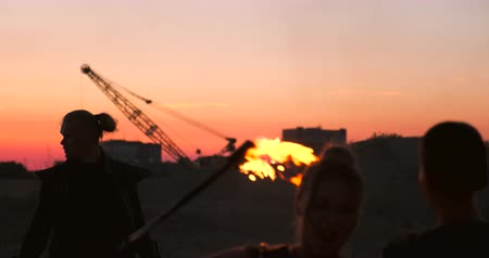 zombi : A man with a flamethrower at sunset in slow motion. Costume for zombie Apocalypse and Halloween. Stok Video