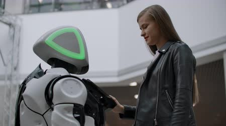 bot : Happy woman in contact with cyborg robot. Click on the robot screen. A droid interacts with a woman. Stock Footage