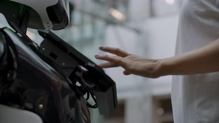 привлекать : Happy woman in contact with cyborg robot. Click on the robot screen. A droid interacts with a woman. Стоковые видеозаписи