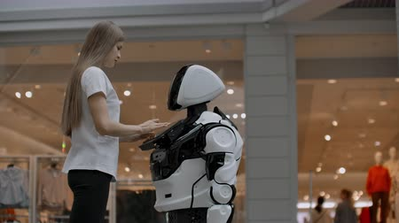 The robot looks at the girl. Artificial intelligence. Modern robotic technologies. The robot looks at the girl with enamored eyes. Modern robotic technologies.