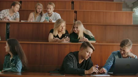 faculty : Friendly student group talking in classroom having break between lessons Stock Footage