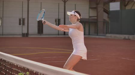 versenyez : Tennis Player Reaching To Hit Ball. Female tennis player reaching to hit the tennis ball on court.