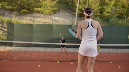 tennis stadium : A tennis player prepares to serve a tennis ball during a match. Stock Footage