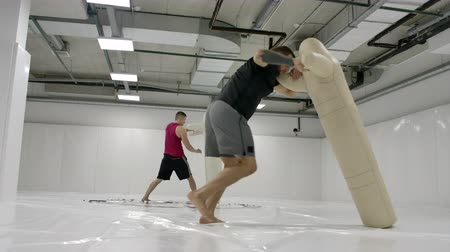 grapple : Two Male wrestlers perform a dummy throw on mats in slow motion. Professional grappling fighters.