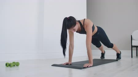 planking : doing exercises on a mat at home