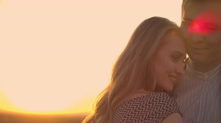 adore : Two lovers dance together on the roof at sunset in the sunlight Stock Footage