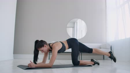 bil : Home exercises for a beautiful body. European brunette woman doing exercises. Stockvideo