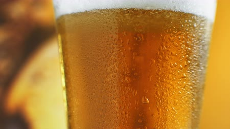 barrilete : Cold Light Beer in a glass with water drops. Craft Beer close up. Rotation 360 degrees