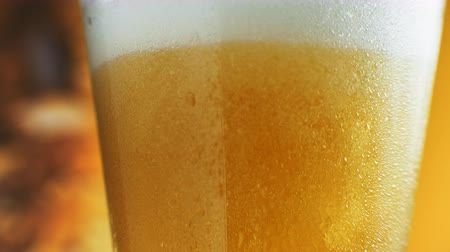 craft beer : Macro Shot Of Fine Bubbles Rising In A Glass With Orange Liquid