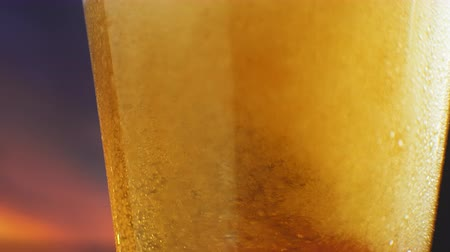 microbrewery : Beer glass close-up. In a glass of beer foam and bubbles in slow motion. In a glass of beer foam and bubbles in slow motion. Beer glass close-up
