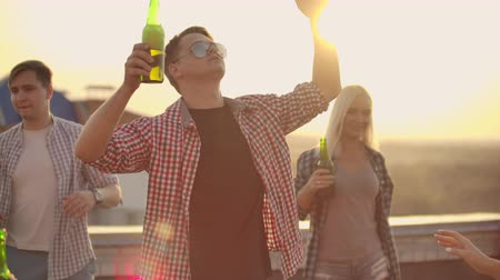 ziyafet : Young male is dancing in trendy glasses Stok Video