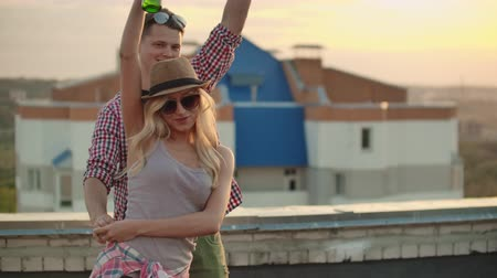 jeans short : Couple is dancing on the roof Stockvideo